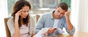young-couple-calculating-bills-Certified Wealth Management & Investment